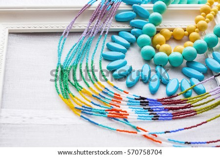 A beaded necklace from colorful beads in the white vintage frame