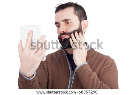 A Bearded Man Holding A Small Mirror With His Hand And