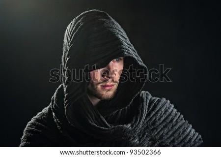 a bearded man in a hood