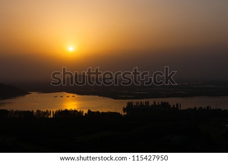 A beautiful aerial view of the sunset over Dal Lake in Srinagar, Kashmir, India