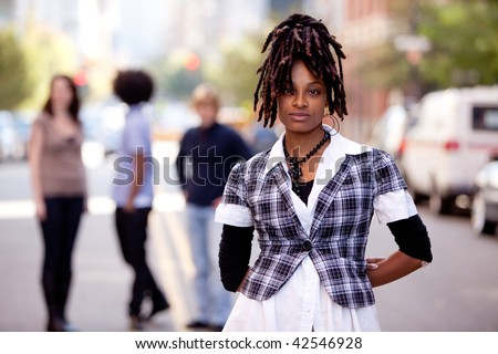 A beautiful african american woman in a city setting with friends