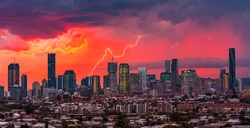 A beautiful afternoon storm over Brisbane city with a lightning bolt