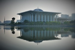 A beautiful and calm view of Sultan Mizan mosque during sunrise with image reflection in Putrajaya, Malaysia