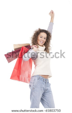 a beautiful and happy girl carrying shopping bags