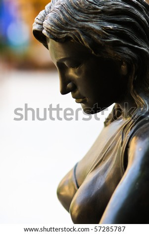 A beautiful and sexy girl statue is feeling sad