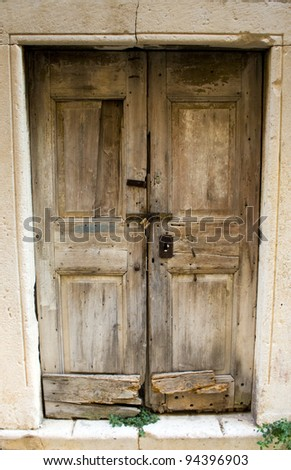 A beautiful architecture on island in Croatia. Old wooden door.