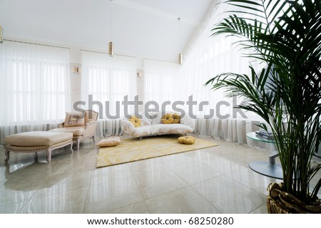 a beautiful armchair and sofa in modern apartment
