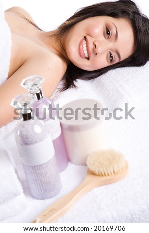 A beautiful asian girl getting a spa treatment in a beauty salon