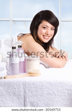 A beautiful asian girl getting ready for a spa treatment in a beauty salon