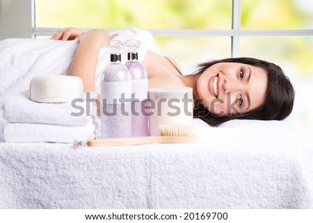 A beautiful asian girl lying down in a beauty spa