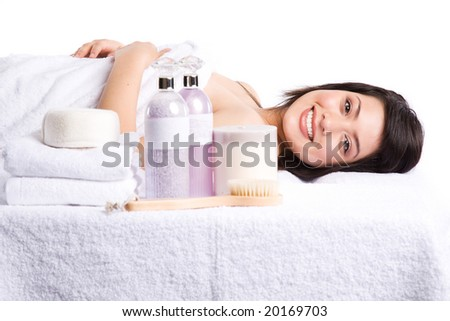 A beautiful asian girl lying down in a beauty spa - stock photo