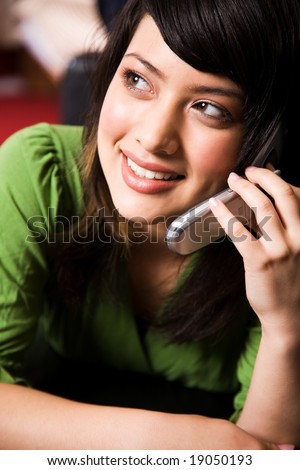 A beautiful asian girl talking on the phone