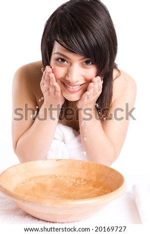 A beautiful asian girl washing face at a spa
