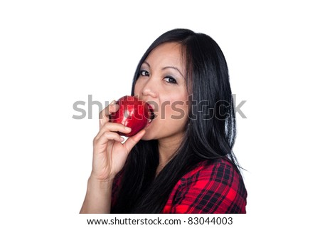 A beautiful Asian woman gets ready to eat an apple.