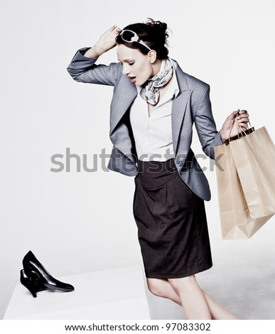 A beautiful attractive woman shopping for new shoes