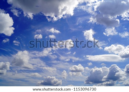 a beautiful background with blue transparent sky air and white fluffy clouds fair weather cumulus humilis on a sunny day
