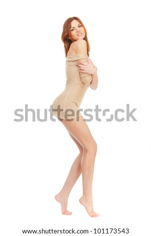 A beautiful barefoot girl with long beautiful legs on a white background. She smiles.