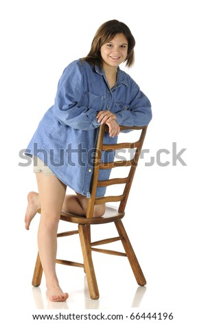 stock photo a beautiful barefoot teen in shorts and an over sized denim shirt leaning on a ladder back chair 66444196 LulzSec Hackers Get Personal, Dump 26000 Porn Site Usernames And Passwords