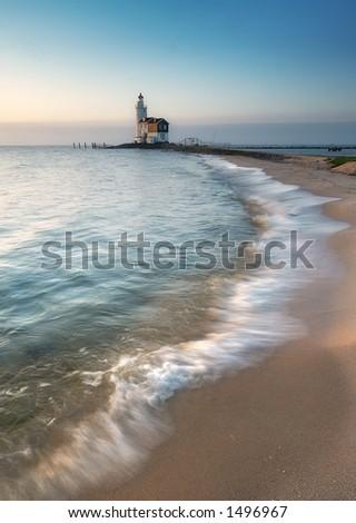 A beautiful beach and lighthouse (Marken The Netherlands)