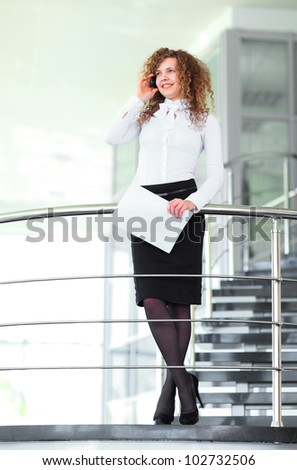 A beautiful blonde business woman on stairs