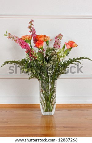 A beautiful bouquet of flowers in a crystal vase.