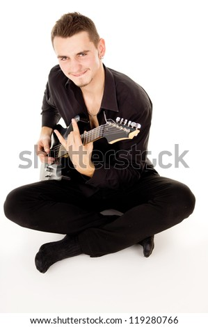a beautiful boy with electric guitar plays-2 - stock photo