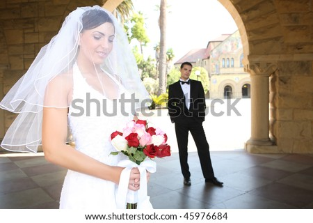 A beautiful bride and  groom at church during wedding
