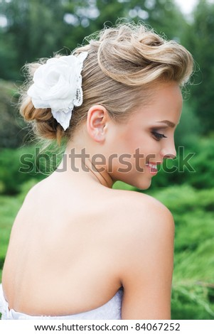 A beautiful bride in the white wedding dress.