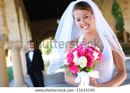 stock photo A beautiful bride with groom in background at church wedding