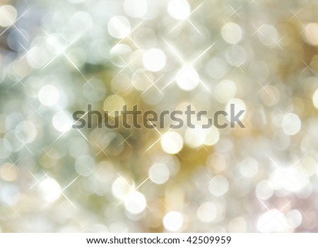 A beautiful bright, silver, golden background with sparkles and dots. A great background for the Holidays, Christmas or New Years. - stock photo