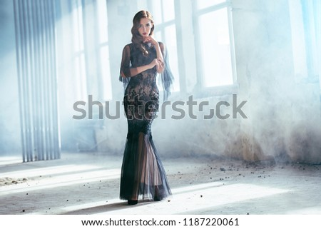A beautiful brunette lady in ruins. Evening dress. Fashion, beauty. #1187220061