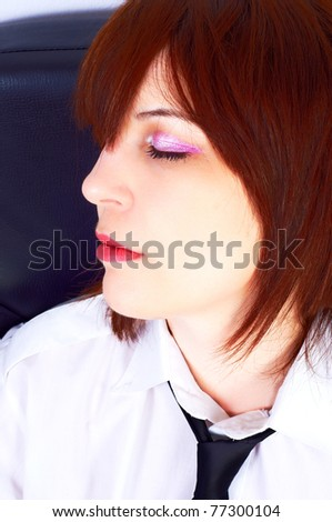 A beautiful business woman sleeping in her chair