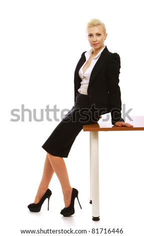 A beautiful businesswoman sitting on a table, isolated on white