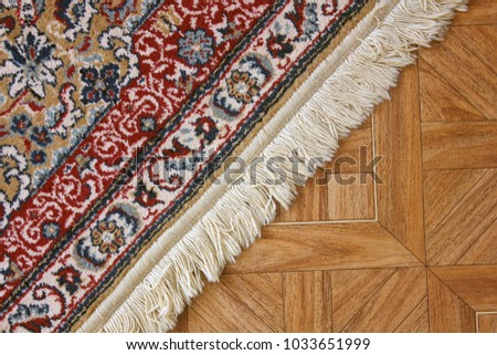 A beautiful carpet on the floor. - Shutterstock ID 1033651999