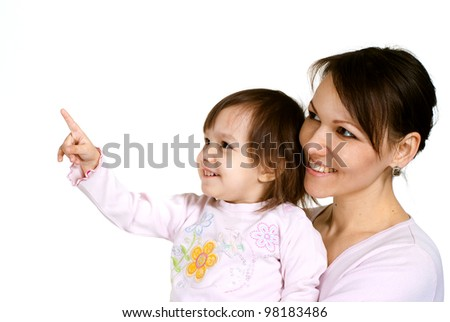 A beautiful Caucasian mother with a beautiful daughter on a light background