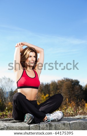 A beautiful caucasian woman doing exercise outdoor in a park
