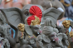 A Beautiful clay statue/Idol of an Indian god Lord Ganesha decorated with colors