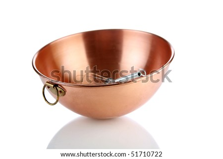 a beautiful copper mixing bowl with a whisk in it on white with nice reflections