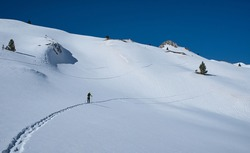 A beautiful day of mountain skiing with perfect conditions.