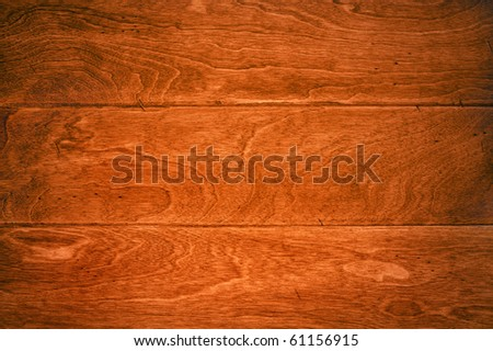A beautiful deep, rich hardwood floor with its wood grain details for use as and background or appropriate housing inference.
