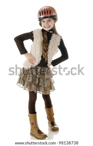 A beautiful elementary girl looking sharp and sassy in her horse-riding helmet and boots.  On a white background.