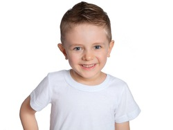 A beautiful European boy in a white t-shirt on a white background. A blue-eyed child of five years old smiles and laughs. Children's emotions.