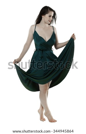 A beautiful fair skinned woman wearing a green dress over a light background. #344945864