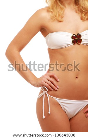A beautiful female body wearing swimsuit, isolated on white background