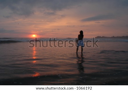 stock photo a beautiful female walk in the water along a isolated tropical beach at sunset in costa rica 1066192 Black And White | This Is Not Porn   Rare and beautiful celebrity photos