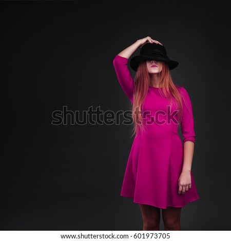 d7ae2a1524d A beautiful girl dressed in crimson holding her hat. Girl holding hat up to  face