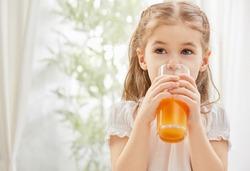 A beautiful girl drinking fresh juice