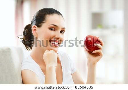 A beautiful  girl eating apple