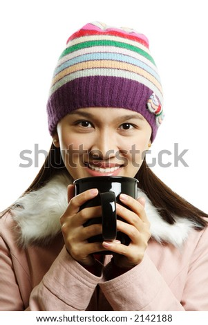 A beautiful girl holding a cup of hot drink
