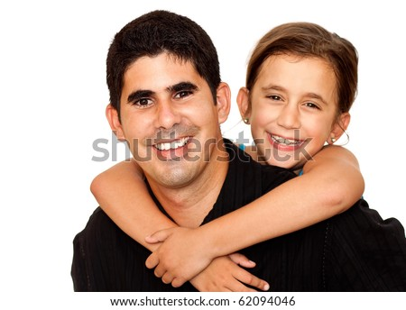 A beautiful girl hugging a smiling young man with her arms around his neck on a white background